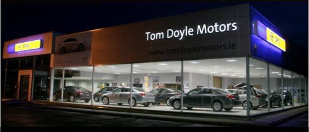 Tom Doyle Dealership night view