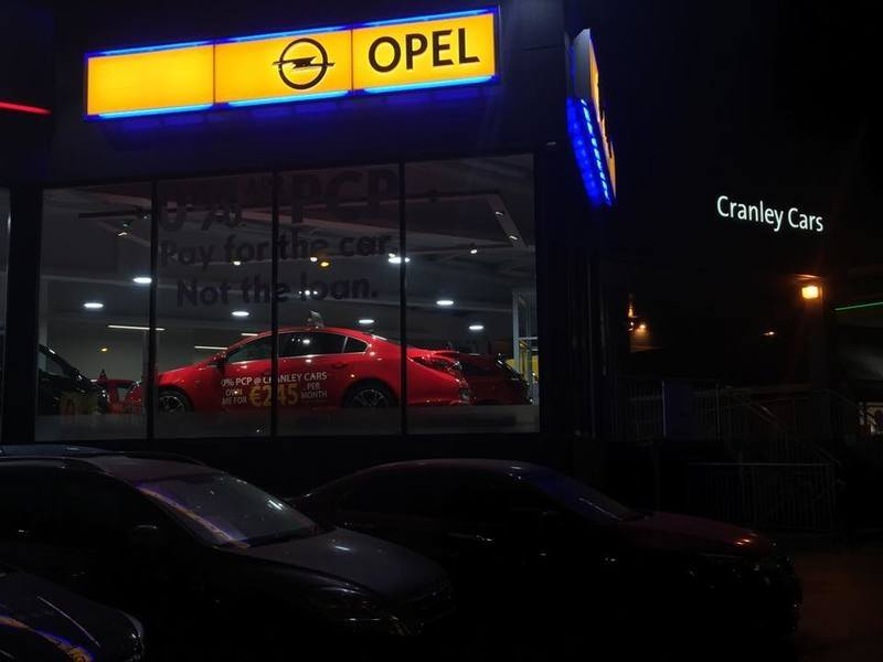 Cranley Cars Opel showroom at night